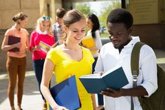 Group of diverse students outside royalty free stock photo