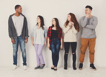 Group of diverse students standing in line indoors Royalty Free Stock Image