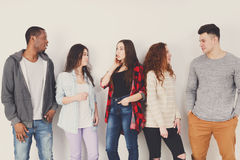 Group of diverse students standing in line indoors Stock Photos