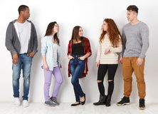 Group of diverse students standing in line indoors Royalty Free Stock Images