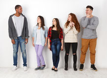 Group of diverse students standing in line indoors Stock Image