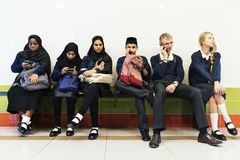 Group of diverse students using mobile phones Stock Image