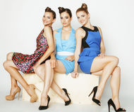 Group of diverse stylish ladies in bright dresses Stock Images