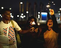 Group of diverse teenagers enjoying the sparklers stock images