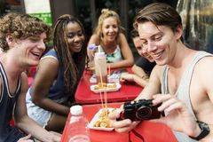 Group of diverse tourist with camera at Bangkok Thailand walking street food stall stock photos