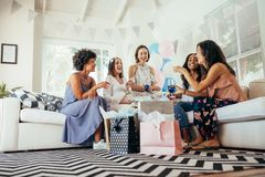 Pregnant woman celebrating baby shower with friends Royalty Free Stock Photo