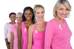 Group of diverse women wearing pink tops and ribbons for breast. Cance on white background Royalty Free Stock Images