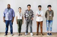 Group of diverse workers standing together Stock Photos