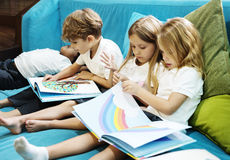 Group of Diverse Young Students Reading Children Story Book Toge. Diverse Young Students Reading Children Story Book Together Royalty Free Stock Image