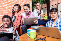 Group of diversity college students learning on campus. Indian, black, and Indonesian people Royalty Free Stock Photos