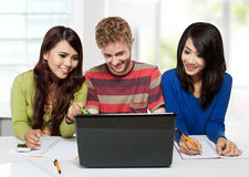 Group of diversity happy students studying together using laptop Stock Image