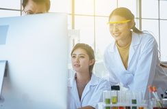 Group of diversity medical student research new project with senior professor together at laboratory royalty free stock photography