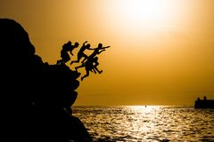 Group dives at sunset. On the beautiful location on the Tenerife, Canary, Spain Stock Image