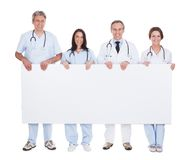 Group of doctor holding placard Stock Image