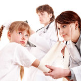Group doctor treat happy child. First aid. Stock Image