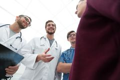 Group of doctors advising the patient. Bottom view.a group of doctors advising the patient Royalty Free Stock Photos