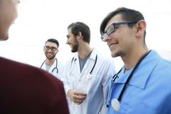 Group of doctors advising the patient royalty free stock photography