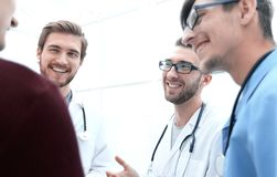 Group of doctors advising the patient. Bottom view.a group of doctors advising the patient royalty free stock images