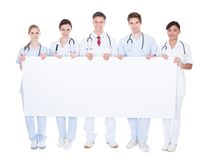Group of doctors with blank billboard Stock Image