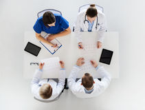 Group of doctors with cardiograms at hospital Stock Image