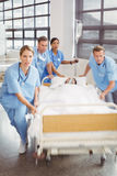 Group of doctors carrying woman patient Stock Photo