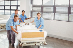Group of doctors carrying woman patient Stock Images