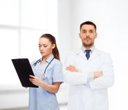 Group of doctors with clipboard and stethoscope Royalty Free Stock Photography