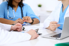 Group of doctors discuss at meeting royalty free stock image