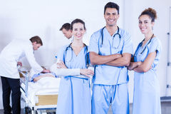 Group of doctors discussing and examining x-ray report. In hospital Stock Image