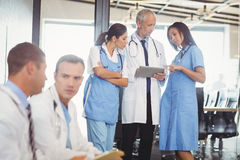 Group of doctors discussing in hospital Stock Photo