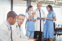 Group of doctors discussing in hospital Royalty Free Stock Photo