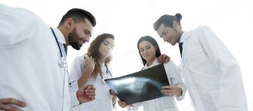Group of doctors discussing an x-ray. Closeup of a group of doctors discussing an x-ray of the patient after surgery Stock Images