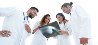 Group of doctors discussing an x-ray. Closeup of a group of doctors discussing an x-ray of the patient after surgery Stock Photography