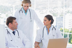 Group of doctors discussing and working together Stock Photography