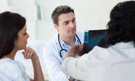 A group of doctors examining an x-ray. In the hospital Stock Image