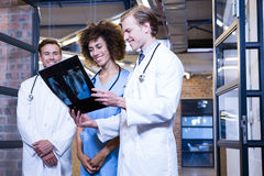 Group of doctors examining a x report. In hospital Royalty Free Stock Photography