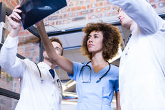 Group of doctors examining a x report. In hospital Royalty Free Stock Photos