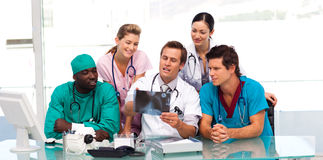 Group of doctors examining an X-ray Stock Image