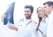 A group of doctors examining an x-ray in the hospital Stock Image