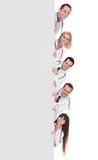 Group of doctors holding placard Stock Photography