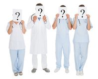 Group Of Doctors Holding Question Mark Sign Royalty Free Stock Photo