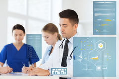 Group of doctors at hospital writing Stock Photos