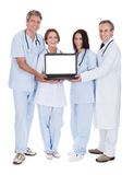 Group Of Doctors With A Laptop Royalty Free Stock Photo