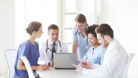 Group of doctors with laptop meeting at hospital stock footage