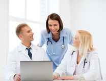 Group of doctors looking at tablet pc Royalty Free Stock Photo