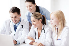 Group of doctors looking at tablet pc Royalty Free Stock Photos
