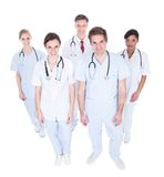 Group of doctors looking up Royalty Free Stock Image