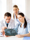 Group of doctors looking at x-ray Royalty Free Stock Photography
