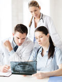 Group of doctors looking at x-ray Stock Photography