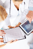 Group of doctors looking at x-ray on tablet pc Stock Image